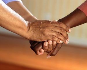 A stock photo of some clasped hands