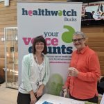 Wendy Mitchell and Alison pose in front of the healthwatch banner