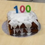 Home made cakes with candles reading 100