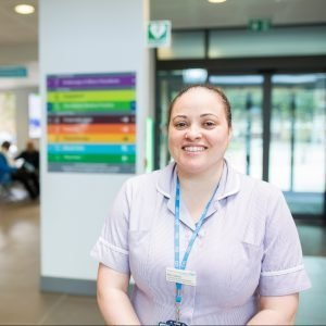 NHS professional smiling