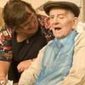 An Elderly Man with his Carer