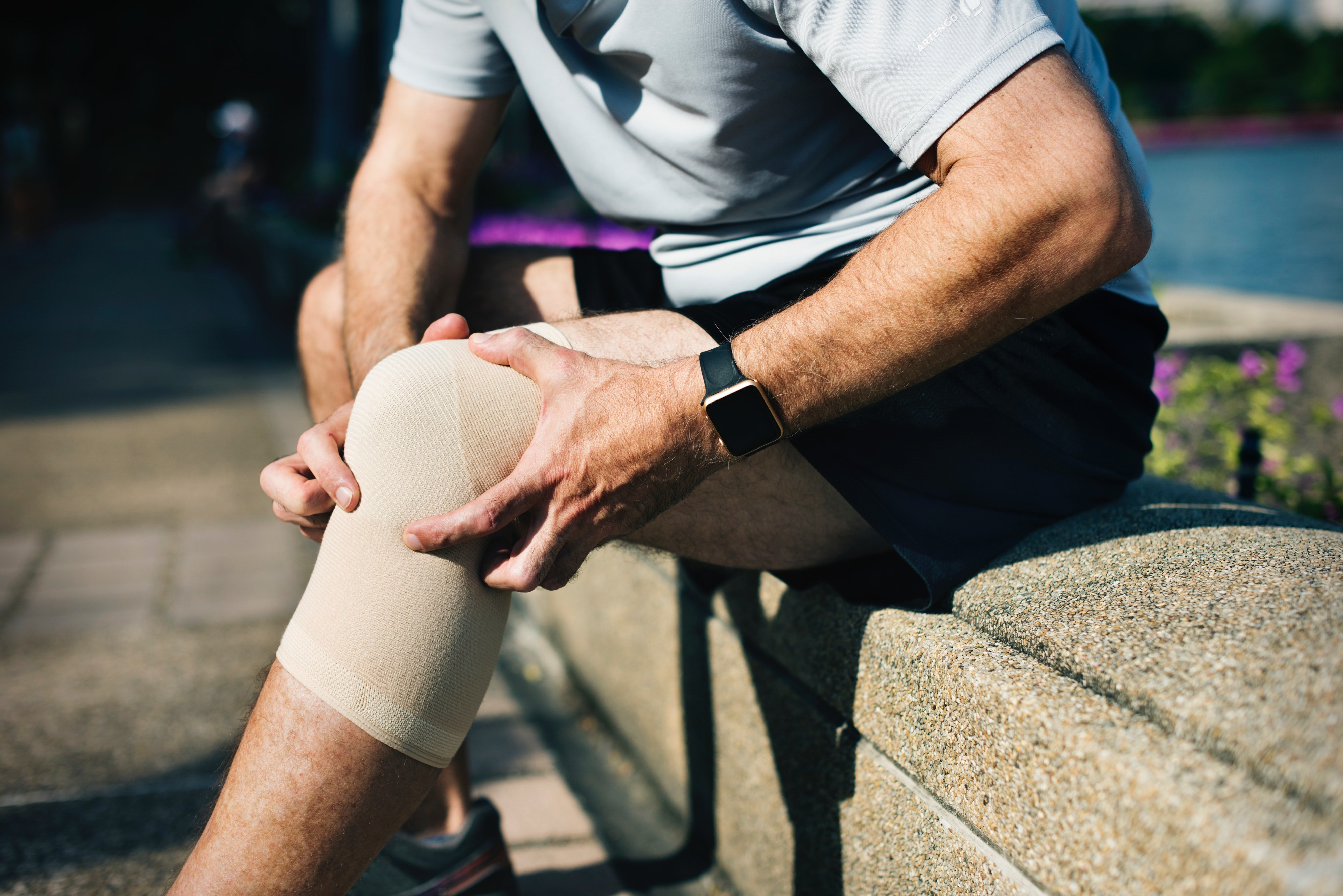 A man wearing a knee support